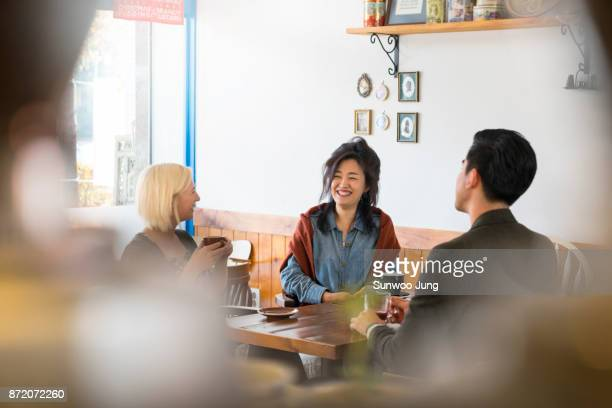 Multicultural family chatting in cafe