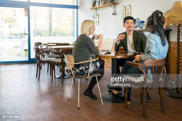 Multicultural family talking in cafe