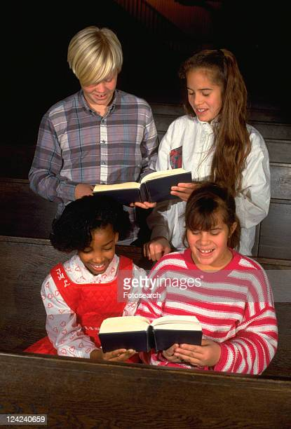 multi-cultural kids singing in church - junior girl models stock pictures, royalty-free photos & images