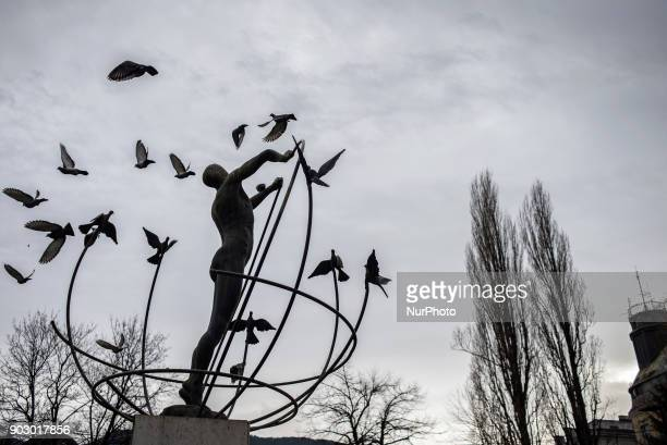 Multicultural Man Builds The World sculpture in Liberation Square Sarajevo Bosnia and Hercegovina on January 9 2018