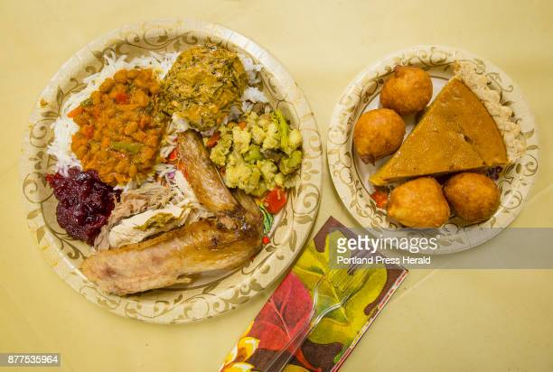 Multicultural offerings including traditional American Thanksgiving turkey stuffing and cranberry sauce are plated with African dishes upper left and...