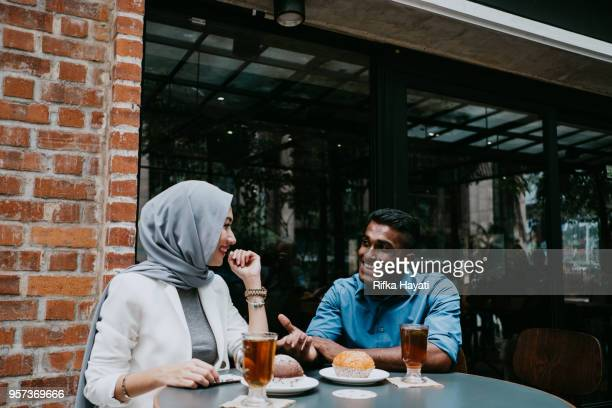 multicultural people having tea time break - rifka hayati stock pictures, royalty-free photos & images
