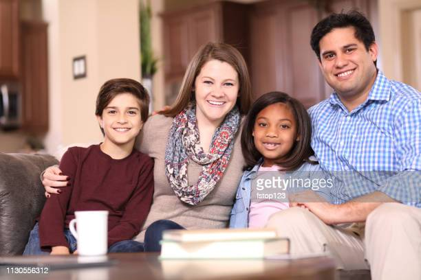 multiethnic-adoption-or-foster-care-family-at-home-picture-id1130556312?s=612x612&profile=RESIZE_400x