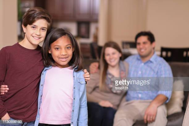 Multi-ethnic, adoption or foster care siblings at home.