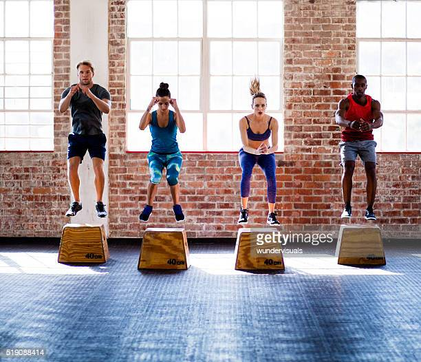 Multi-ethnic athletes focused on workout at the gym