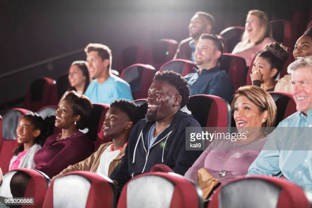 multi-ethnic audience, family watching movie in theater - performing arts event stock pictures, royalty-free photos & images