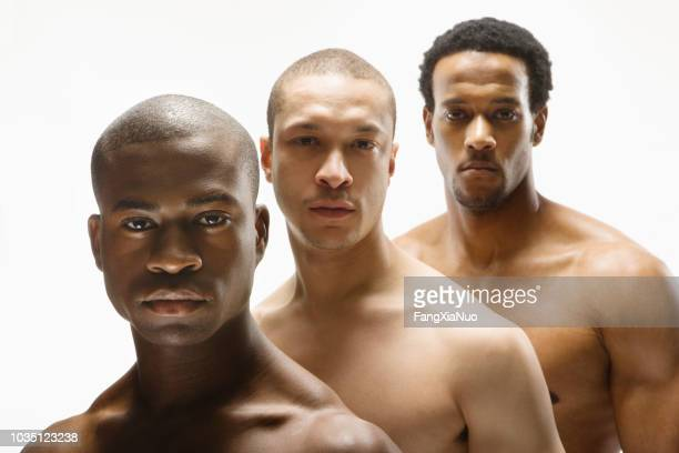 multi-ethnic bare cheated men in row - naked indian men stock pictures, royalty-free photos & images
