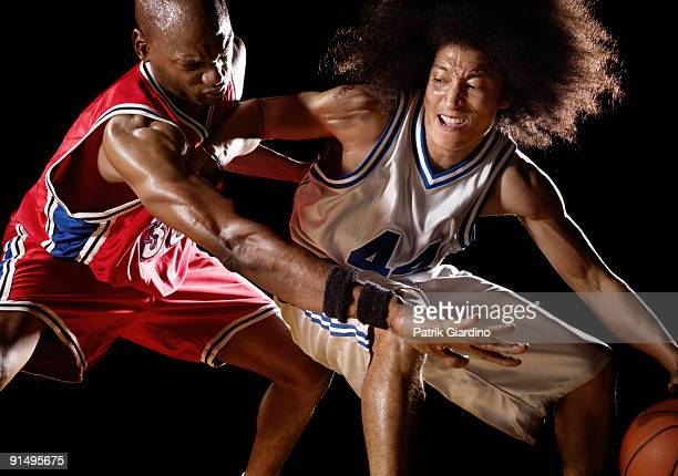 Multi-ethnic basketball players competing for basketball