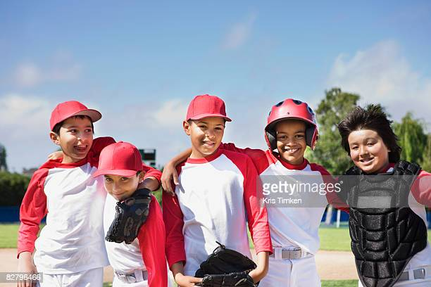 multi-ethnic boys in baseball uniforms - baseball team stock pictures, royalty-free photos & images