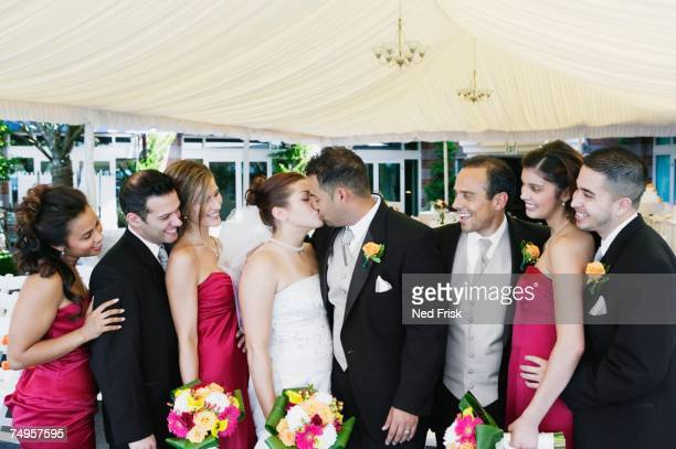 Multi-ethnic bride and groom kissing