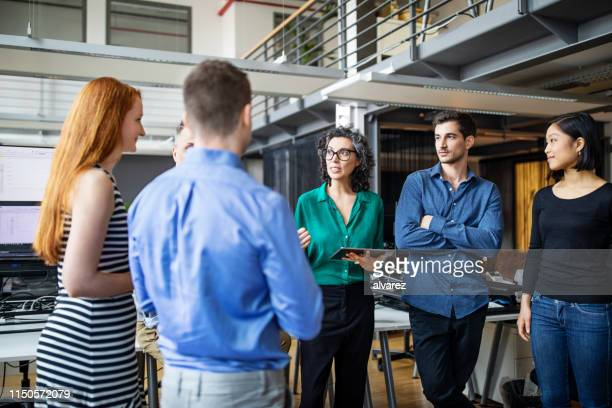 multi-ethnic business colleagues having brainstorming session - casual clothing stock pictures, royalty-free photos & images