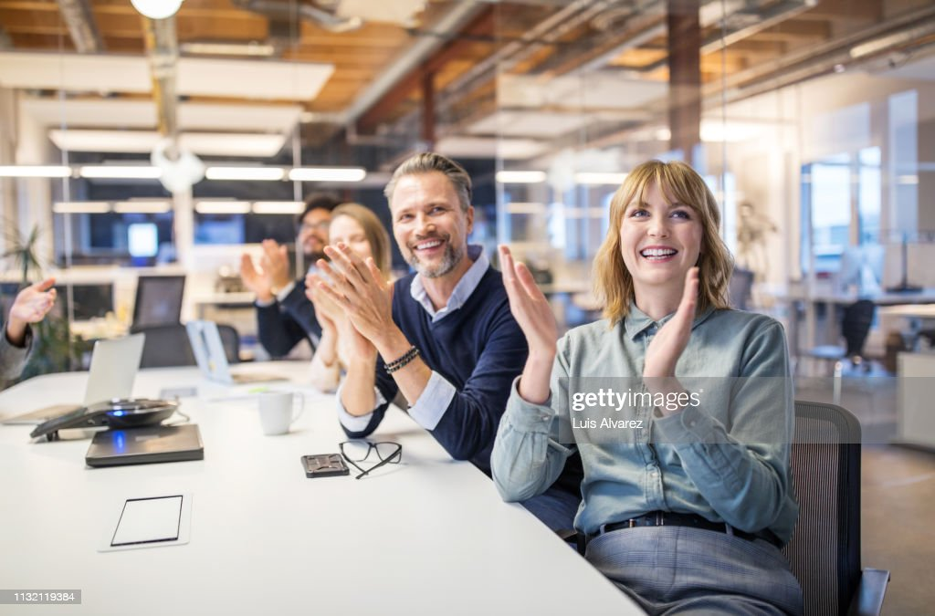 Multi-ethnic business group applauding in meeting : Stock Photo
