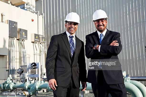 Multi-ethnic business men outside industrial plant