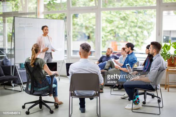 multi-ethnic business people attending meeting - demonstration stock pictures, royalty-free photos & images