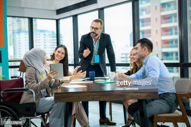 multi-ethnic business people colleague working in the office. diversity business teamwork. - islam stock pictures, royalty-free photos & images