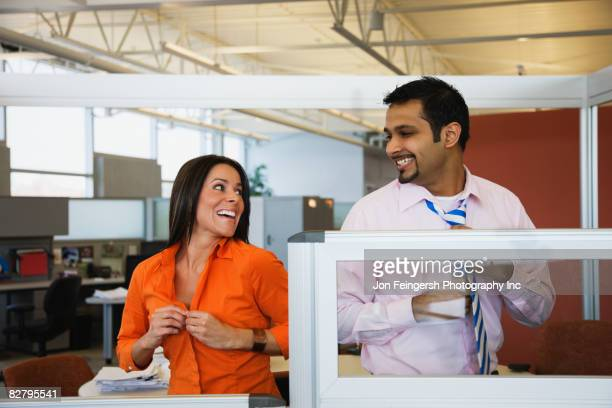 Multi-ethnic business people dressing in office
