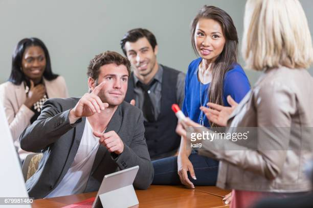 multi-ethnic business people meeting in board room - candid forum stock pictures, royalty-free photos & images