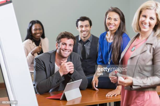 Multi-ethnic business people meeting in board room