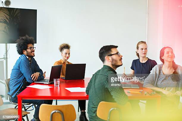 Multi-ethnic business people sitting in conference room