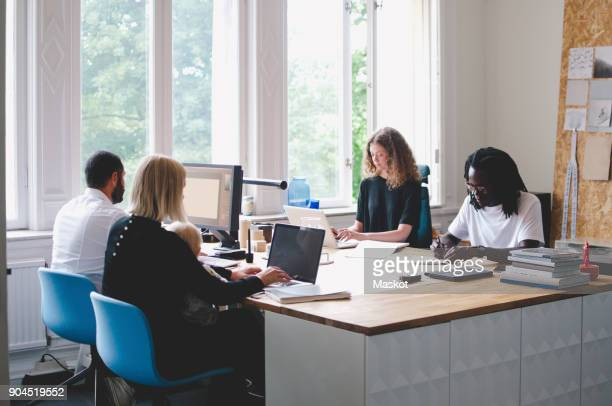Multi-ethnic business people working in creative office