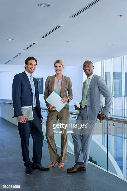 multi-ethnic business professionals in office - pant suit stock pictures, royalty-free photos & images