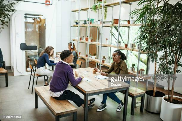 multi-ethnic business team having meeting in the office - business finance and industry stock pictures, royalty-free photos & images