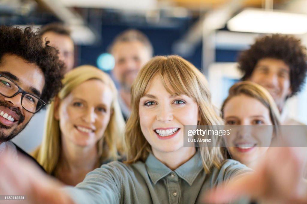 Multi-ethnic business team taking a selfie : Photo