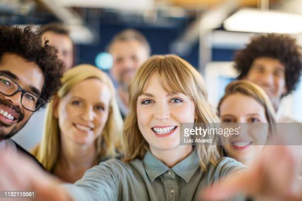 multi-ethnic business team taking a selfie - employee stock pictures, royalty-free photos & images