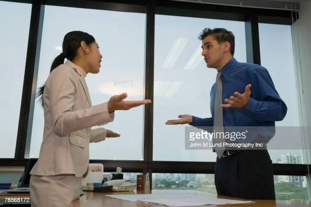 Multi-ethnic businesspeople arguing