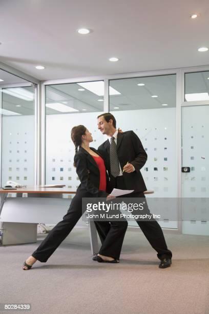 Multi-ethnic businesspeople dancing