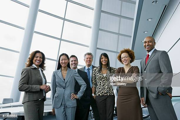 multi-ethnic businesspeople in conference room - multiculturalism stock pictures, royalty-free photos & images