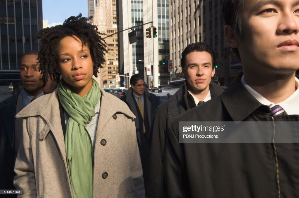 Multi-ethnic businesspeople in urban scene : Stock Photo