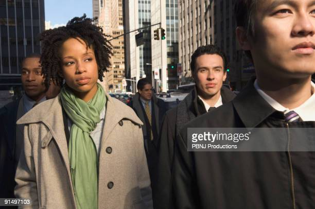 Multi-ethnic businesspeople in urban scene