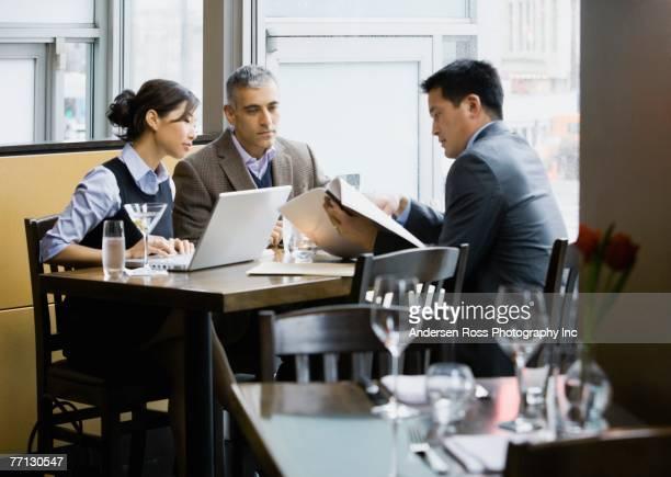 Multi-ethnic businesspeople meeting at restaurant