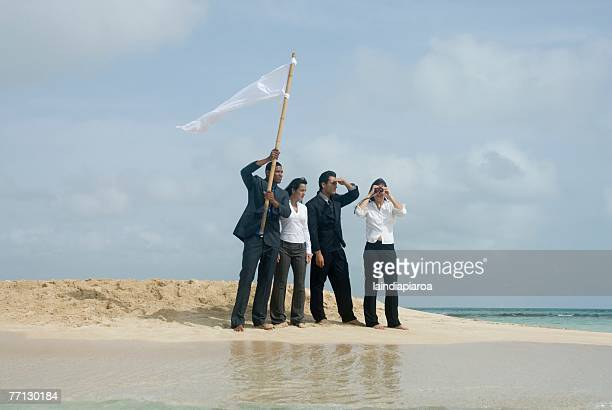 multi-ethnic businesspeople with flag at beach - sos einzelwort stock-fotos und bilder