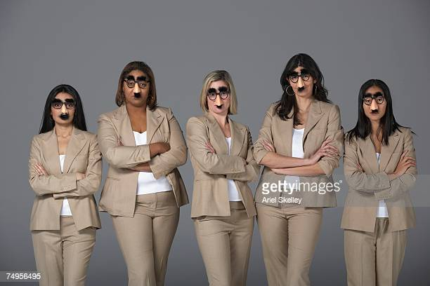 multi-ethnic businesswoman wearing groucho glasses - groucho marx stock photos and pictures