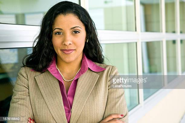 multi-ethnic businesswoman with arms crossed - puerto rican ethnicity stock pictures, royalty-free photos & images