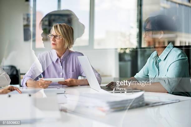 Multi-ethnic businesswomen discussing in office