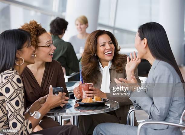 Multi-ethnic businesswomen having coffee