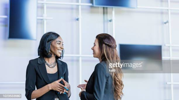 multi-ethnic businesswomen talking - face to face stock pictures, royalty-free photos & images