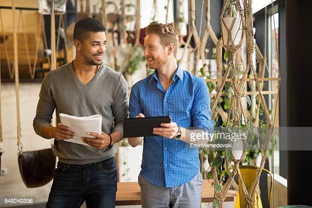 Multi-ethnic casual businessmen having meeting in coffee shop.
