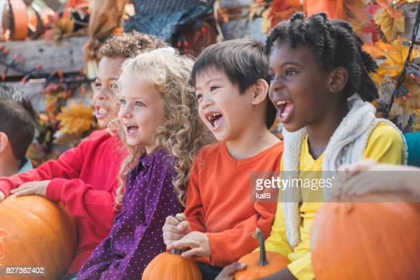 multi-ethnic children at autumn festival - traditional festival stock pictures, royalty-free photos & images
