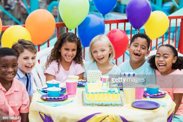 multi-ethnic children at birthday party - birthday party stock photos and pictures