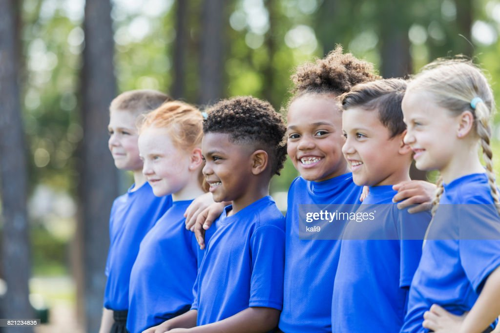 Multi-ethnic children at soccer camp : Stock Photo