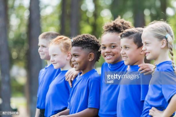 Multi-ethnic children at soccer camp