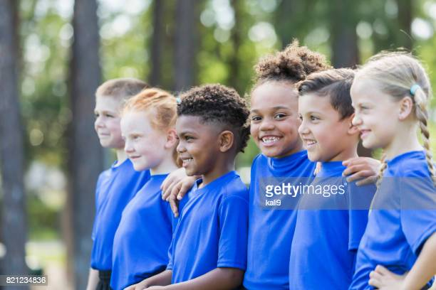 multi-ethnic children at soccer camp - sports training camp stock pictures, royalty-free photos & images