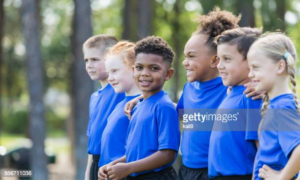 multi-ethnic children at soccer camp - minority groups stock pictures, royalty-free photos & images
