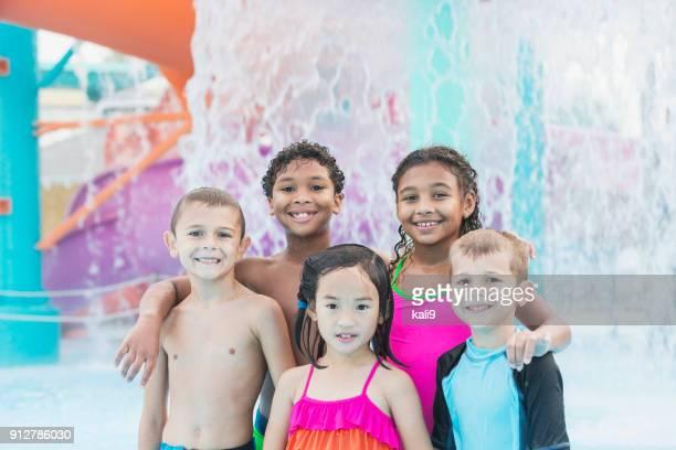 Multi-ethnic children at water park