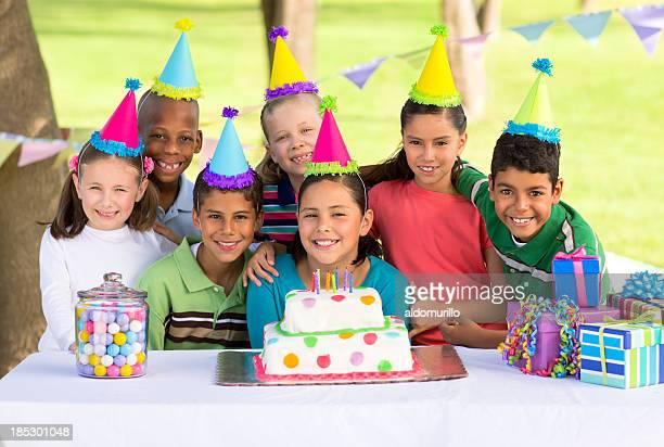 Multi-ethnic children celebrating a birthday