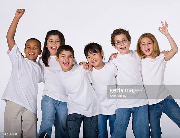 Multi-ethnic children cheering